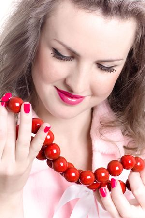 closeup portrait of attractive brunet woman with red beads Stock Photo - 8157156