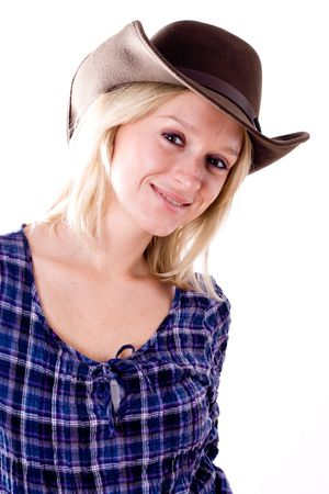 beautiful western woman in cowboy shirt and hat isolated on white background photo