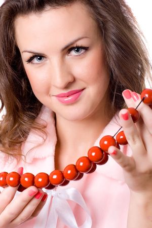 closeup portrait of attractive brunet woman with red beads photo