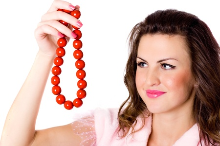portrait of attractive brunet woman with red beads on white background photo