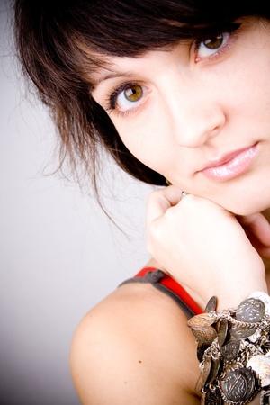 closeup portrait of young brunette lady with bracelets Stock Photo - 8316565