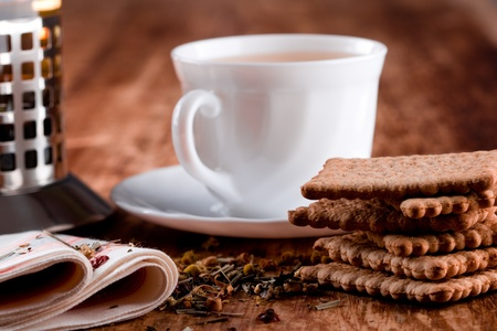 french press, cup of fresh herbal tea and some cookies closeup on wooden table Stock Photo - 8360700