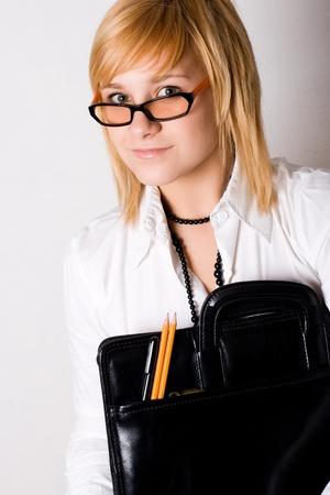 young businesswoman with portfolio on white background photo