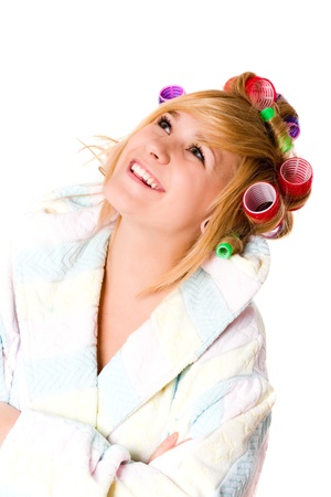 closeup portrait of happy housewife with curlers on white background photo