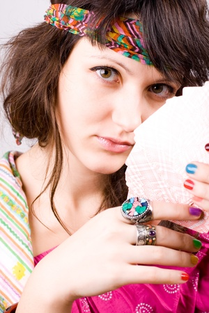 summoning: closeup portrait of soothsayer with scrying cards