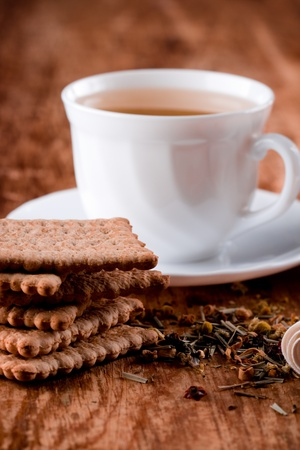 cup of fresh herbal tea and some cookies closeup on wooden table Stock Photo - 8438496