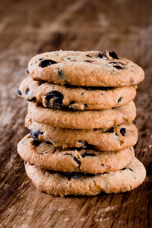 stack of fresh baked cookies closeup on wooden background photo