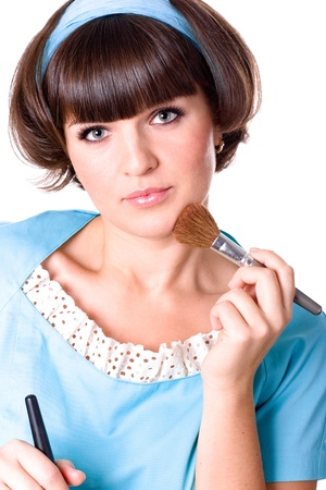 portrait of attractive brunet woman in blue dress with two make-up brushes isolated on white background Stock Photo - 8646095