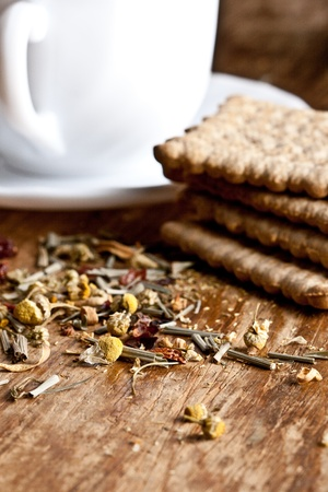 cup of fresh herbal tea and some cookies closeup on wooden table Stock Photo - 8753787