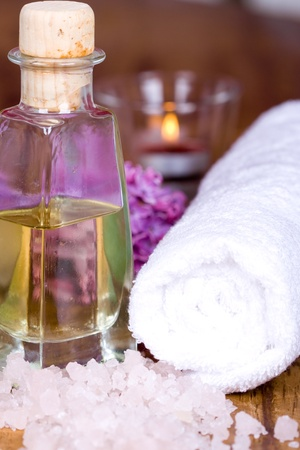 bath and spa items (towel, salt, oil, lilac, candle) on wooden background Stock Photo - 8753804