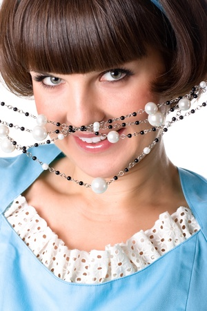 closeup portrait of attractive brunet woman in blue dress with pearl beads photo
