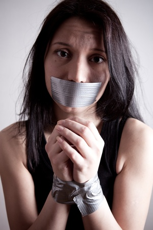 kidnapped young woman, hostage closeup on white background Stock Photo - 8889964