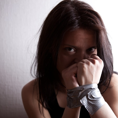 kidnapped young woman, hostage closeup on white background Stock Photo - 9228659