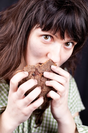 portrait of a poor beggar woman eating bread in her hands Stock Photo - 9255128