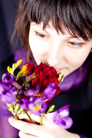portrait of beautiful woman with purple and red flowers Stock Photo - 9630956