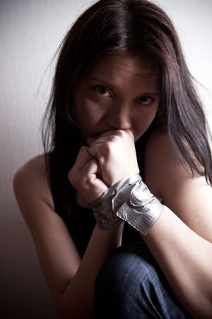 kidnapped young woman, hostage closeup on white background Stock Photo - 11489392