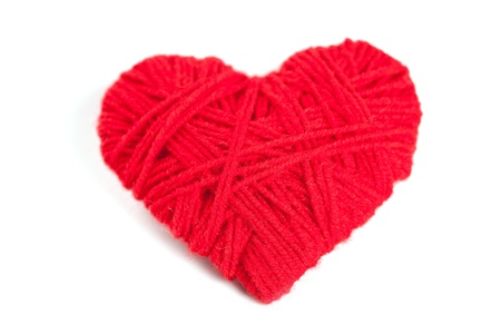 red thread heart isolated on white background photo