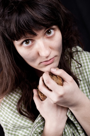 portrait of a poor beggar woman with a piece of bread in her hands Stock Photo - 11489421