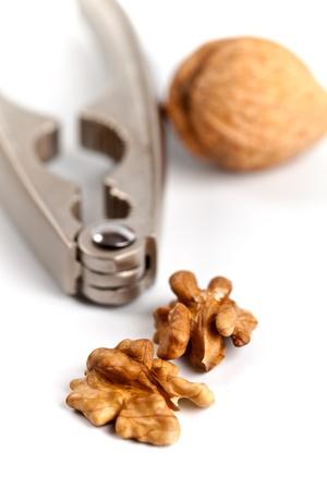walnuts and nutcracker closeup on white background  Stock Photo - 12516620
