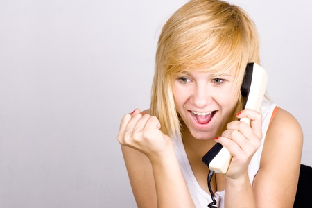 closeup portrait of blond woman with retro telephone photo