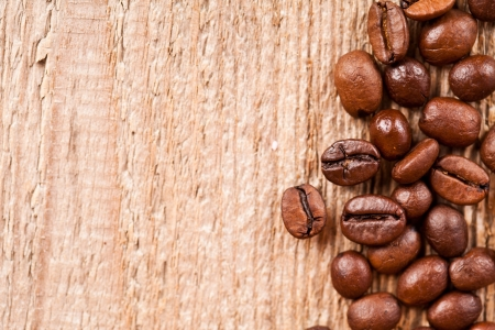 fresh coffee beans on rustic wooden board macro image Stock Photo