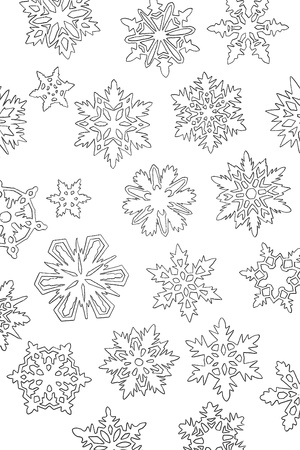 a lot of paper white cutout snowflakes on background Stock Photo
