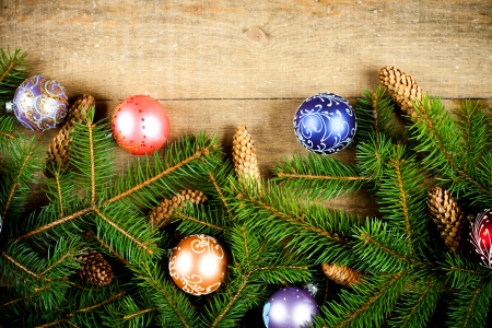 christmas fir tree with pinecones and decorations on a wooden board Stock Photo - 16172805