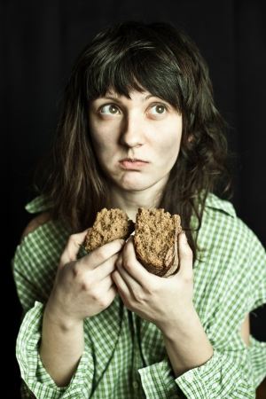 portrait of a poor beggar woman eating bread Stock Photo - 18571968
