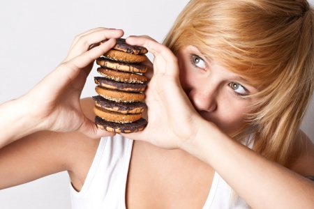 portrait of young woman with chocolate chip cookies photo