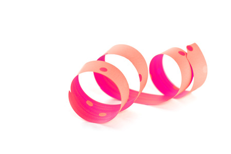 pink ribbon serpentine isolated on white background  photo