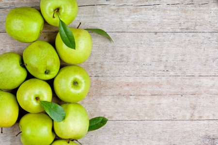 fresh green apples closeup on wooden background  Stock Photo