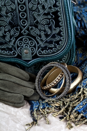 vintage bag, leather gloves, bracelets and scarf closeup photo
