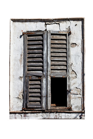 closed window with old wood shutters on white background photo