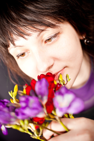 portrait of beautiful woman with purple flowers photo