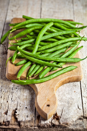 green string beans closeup on wooden board photo