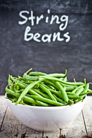 green string beans in a bowl and blackboard photo