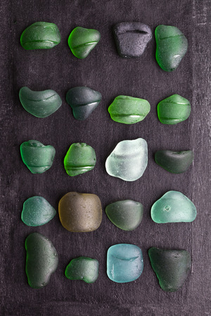 bottlenecks: collection of old sea glass bottlenecks on blackboard background