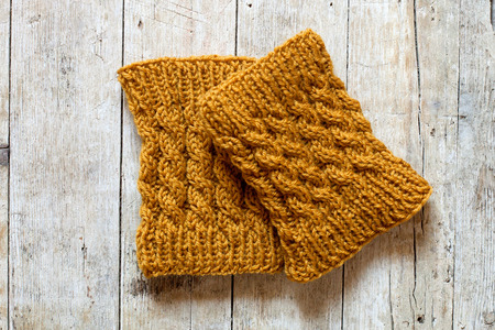 leg warmers: knitted wood legwarmers on wooden background