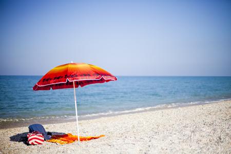 thunderhead: Red umbrella on tropical beach, Italian summer