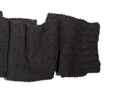 Knitted wool dark grey scarf isolated on white background.