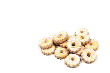 Fresh baked cookies heap topview on white background. Stock Photo