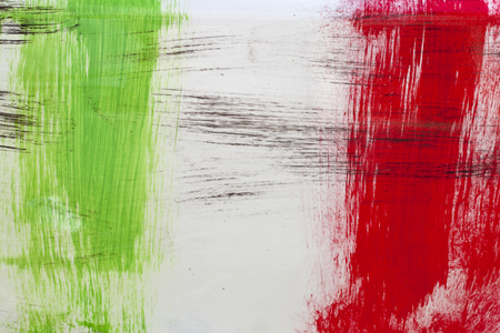 Italy. Italian flag painted with three vertical brush strokes on white background. Archivio Fotografico
