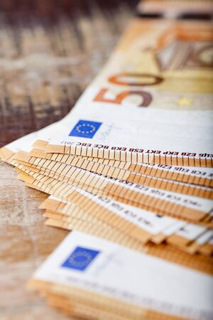 Pile of fifty euro banknotes. 50€ currency notes stacked. Money bank finance business concept. Selective focus. Stockfoto