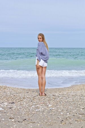 Beautiful girl in sea style on the Adriatic beach. Travel and vacation. Freedom Concept. Sensual blonde beautiful woman, Girl with perfect body and long hair, marine style.  Stockfoto