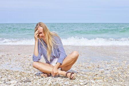 Beautiful happy girl on the Adriatic beach. Travel and vacation. Freedom concept. Sensual blonde beautiful woman, Girl with perfect body and long hair, marine style. With copy space.  Stockfoto