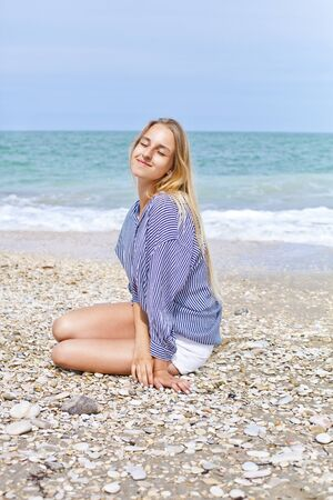 Beautiful happy girl on the Adriatic beach. Travel and vacation. Freedom concept. Sensual blonde beautiful woman, Girl with perfect body and long hair, marine style.