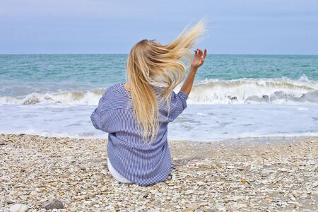 Beautiful girl in sea style on the Adriatic beach. Travel and vacation. Freedom Concept. Sensual blonde beautiful woman, Girl with long hair, marine style.  Stockfoto