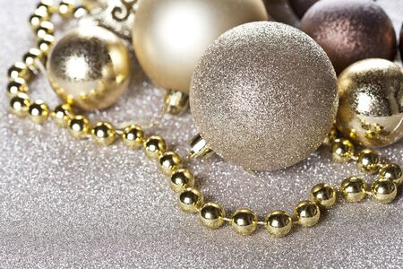 Christmas golden and brown decorations closeup on glitter background. With copy space. Stockfoto
