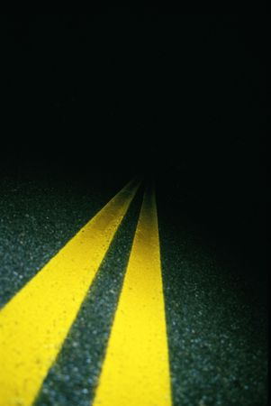 nightime: Double yellow lines on road at night Stock Photo