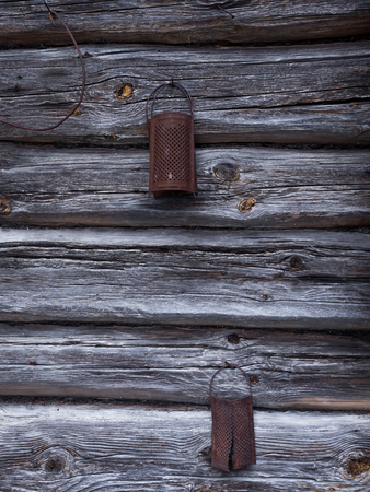 metal grate: the natural aged old rusted grater on the wooden wall Stock Photo